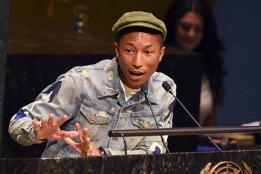Live Earth organisers had yet to reveal any ticket arrangements or artists other than Happy creator Pharrell Williams (above), who was involved in the planning. -- PHOTO: AFP
