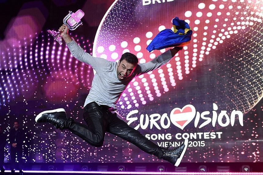 Mans Zelmerloew of Sweden celebrating his victory at the Grand Final of the 60th annual Eurovision Song Contest (ESC) at the Wiener Stadthalle in Vienna, Austria, on May 23, 2015. -- PHOTO: EPA
