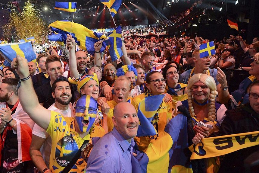 Fans from Sweden celebrate a Swedish victory at the Grand Final of the 60th annual Eurovision Song Contest (ESC) at the Wiener Stadthalle in Vienna, Austria, on May 23, 2015. -- PHOTO: EPA