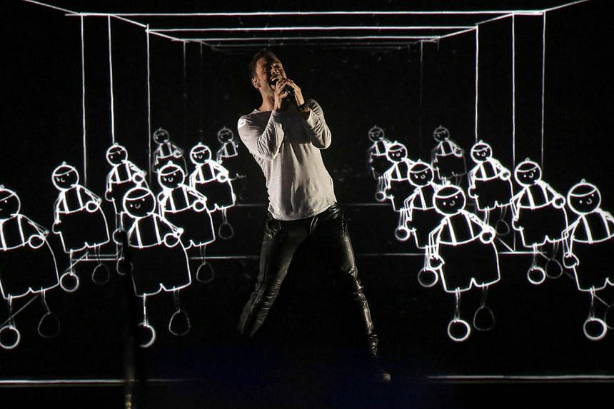 Sweden's Mans Zelmerlow performs after winning the 60th Eurovision Song Contest final on May 23, 2015 in Vienna. -- PHOTO: AFP