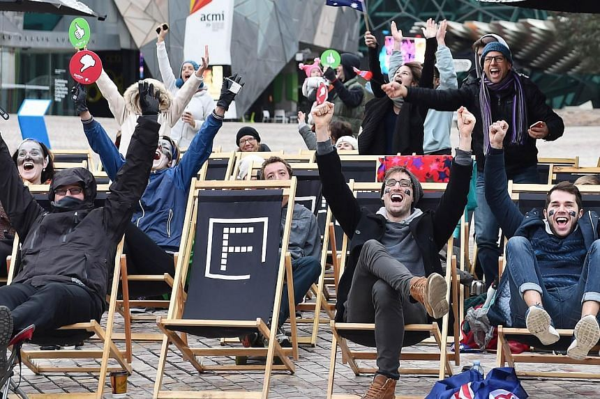 Fans of Australian singer Guy Sebastian, who represented his country as a wild card at the 60th Eurovision Song Contest, cheer as he is awarded 12 points during a screening event of the tournament at Federation Square in Melbourne on May 24, 2015. --