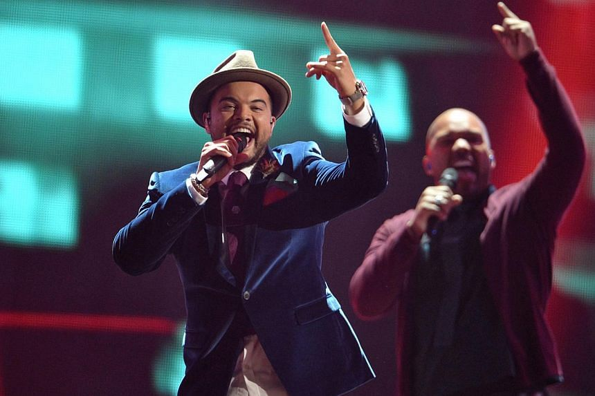 Singer Guy Sebastian (left) of Australia performs during the Grand Final of the 60th annual Eurovision Song Contest (ESC) at the Wiener Stadthalle in Vienna, Austria, on May 23, 2015. -- PHOTO: EPA