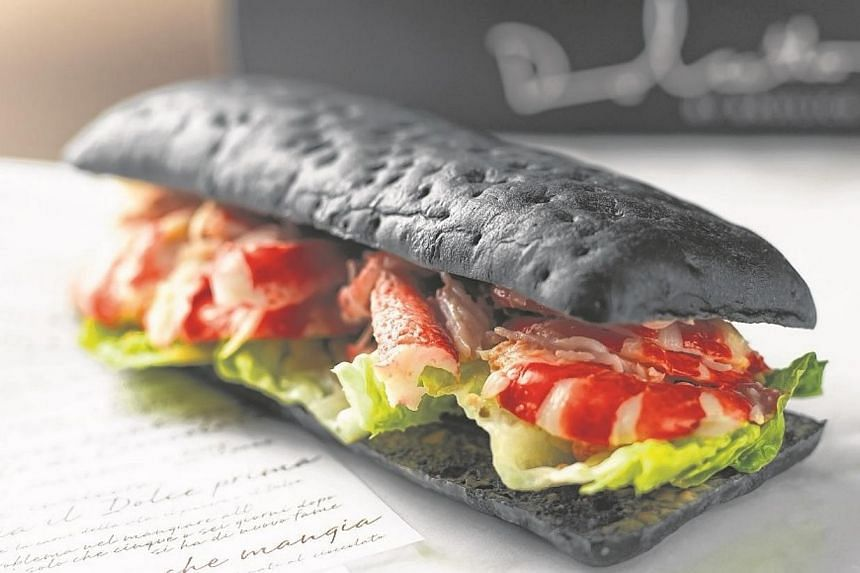 A squid ink panini with king crab and prawns is also on Dolcetto's menu. -- PHOTO: REGENT SINGAPORE
