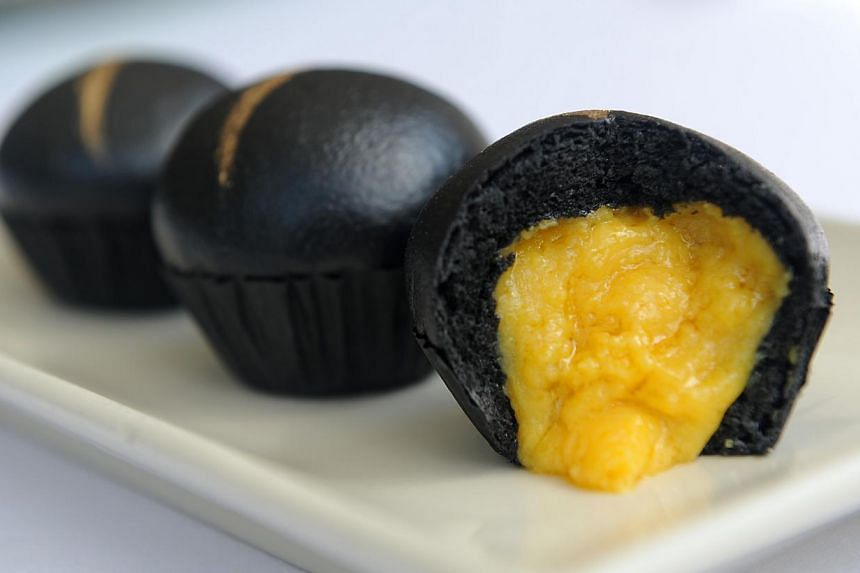 The mini black charcoal egg custard bun, created by Min Jiang's chef Chan Hwan Kee. -- ST PHOTO: TIFFANY GOH