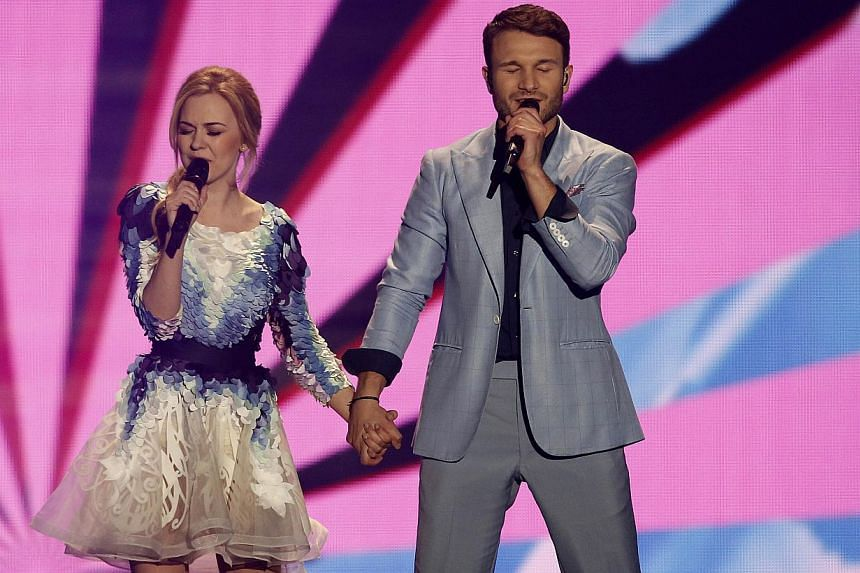 Lithuania's Monika Linkyte and Vaidas Baumila performs during the 60th Eurovision Song Contest final on May 23, 2015 in Vienna. -- PHOTO: AFP