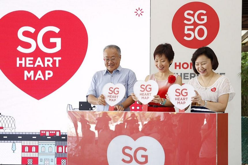 (From left) HDB chairman James Koh, Minister in the Prime Minister's Office Grace Fu and HDB CEO Dr Cheong Koon Hean, who is also the chairman of SG Heart Map Steering Committee, trigger a launch mechanism to unveil the 50 SG Heart Map places at Sent