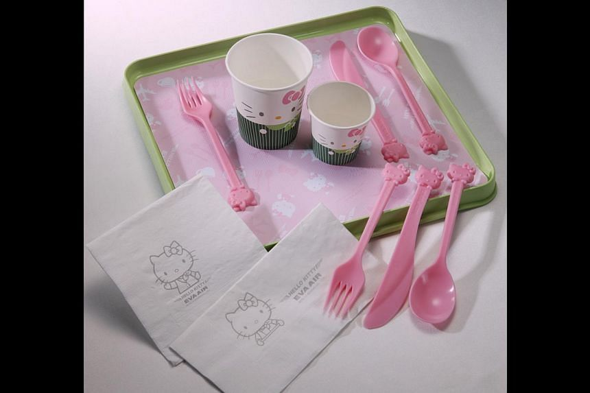 Relish meals with Hello Kitty utensils (above) that are served by stewardesses wearing Hello Kitty aprons. -- PHOTO: EVA AIR