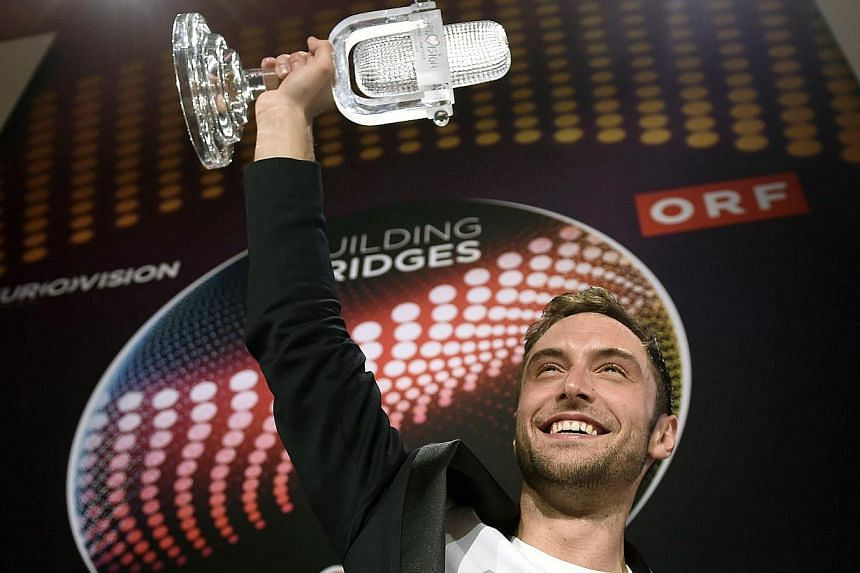 Eurovision Song Contest winner Mans Zelmerlow of Sweden reacts with his trophy during the winner's press conference after at the Wiener Stadthalle in Vienna, Austria, on May 23, 2015. -- PHOTO: EPA