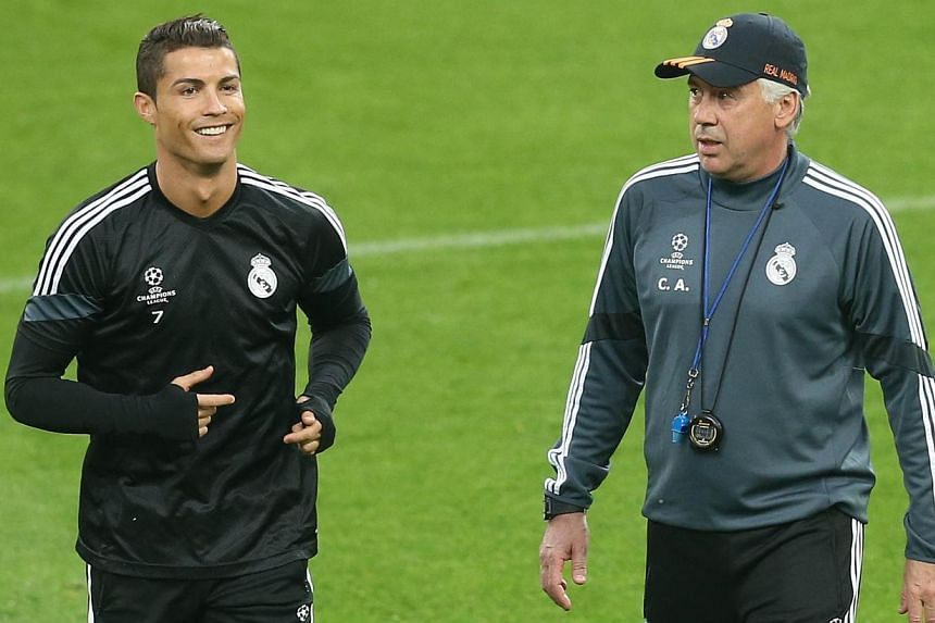 Real Madrid forward Cristiano Ronaldo (left) and coach Carlo Ancelotti at a training session on May 4, 2015. -- PHOTO: AFP