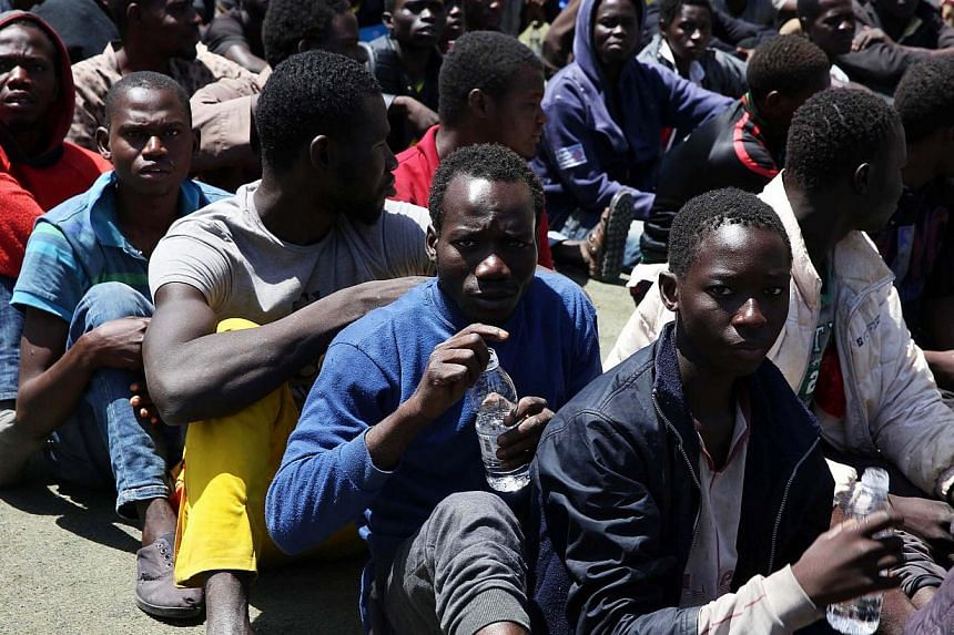 Libyan authortities detain 600 people they suspect were trying to cross illegally to Europe, now being held in Tripoli, Libya, May 23, 2015. -- PHOTO: EPA