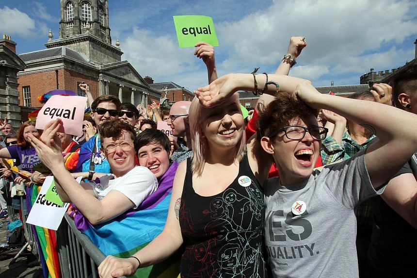 Supporters for same-sex marriage raise a cheer at Dublin Castle as they wait for the result of the referendum on May 23, 2015. -- PHOTO: AFP
