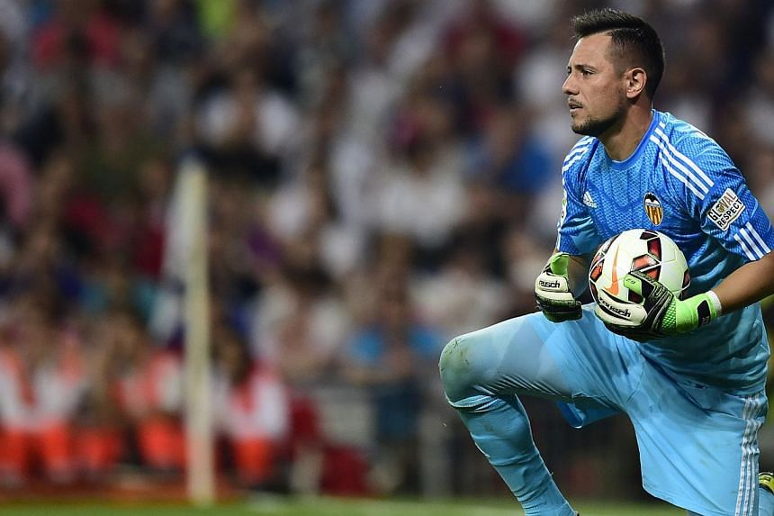 Valencia's goalkeeper Diego Alves holds the ball during the Spanish league football match Real Madrid CF vs Valencia CF at the Santiago Bernabeu stadium in Madrid on May 9, 2015. -- PHOTO: AFP