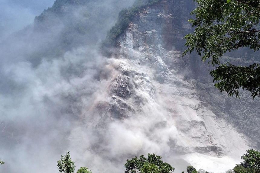 A handout photograph released by the Nepal Army on Sunday, May 24, 2015, shows an area in Nepal's mountainous north-west Myagdi district affected by a landslide.A river dammed up by the landslide has begun flowing again, but the risks of flash