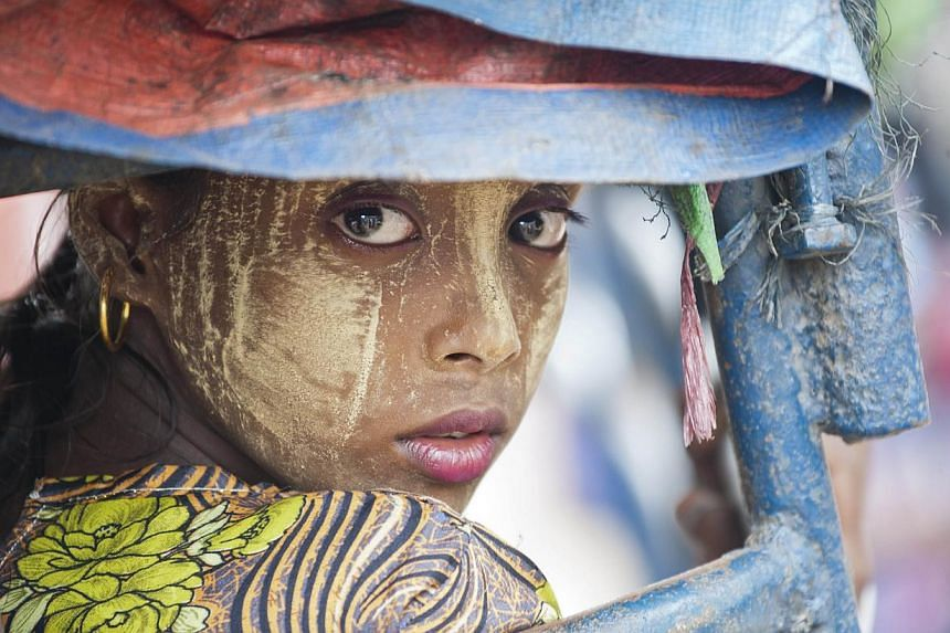 Myanmar has enacted a population law that rights groups said on Sunday targets persecuted Rohingya Muslims, a minority group at the centre of a migration crisis that has seen thousands flee the country. -- PHOTO: AFP