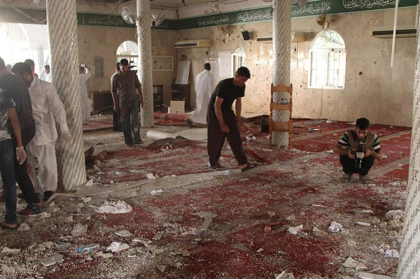 People examine the debris after a suicide bomb attack at the Imam Ali mosque in the village of al-Qadeeh in the eastern province of Gatif, Saudi Arabia on May 22, 2015. -- PHOTO: REUTERS