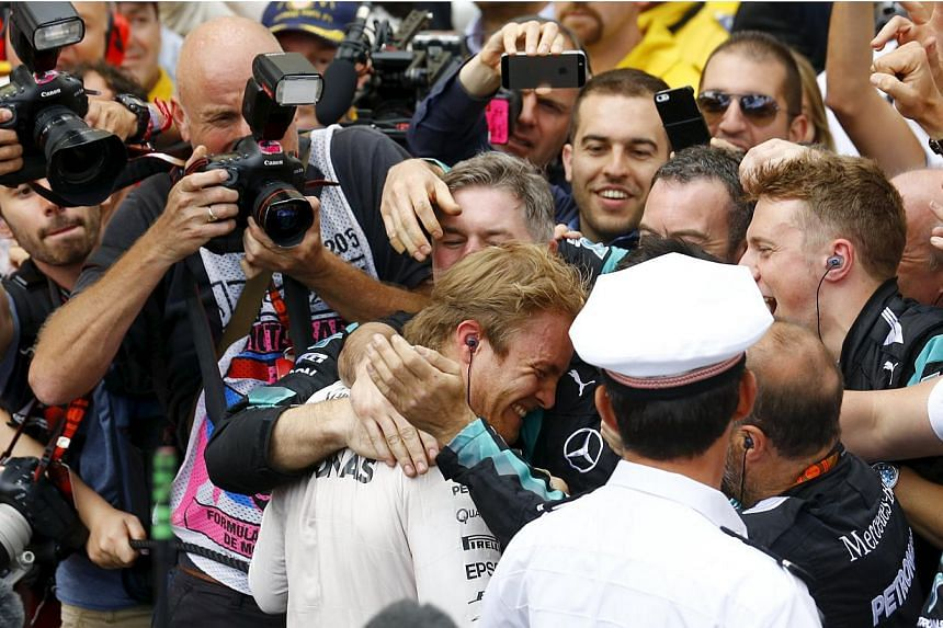 Mercedes Formula One driver Nico Rosberg of Germany (centre) celebrates with members of his team after winning the Monaco F1 Grand Prix in Monaco on May 24, 2015. -- PHOTO: REUTERS