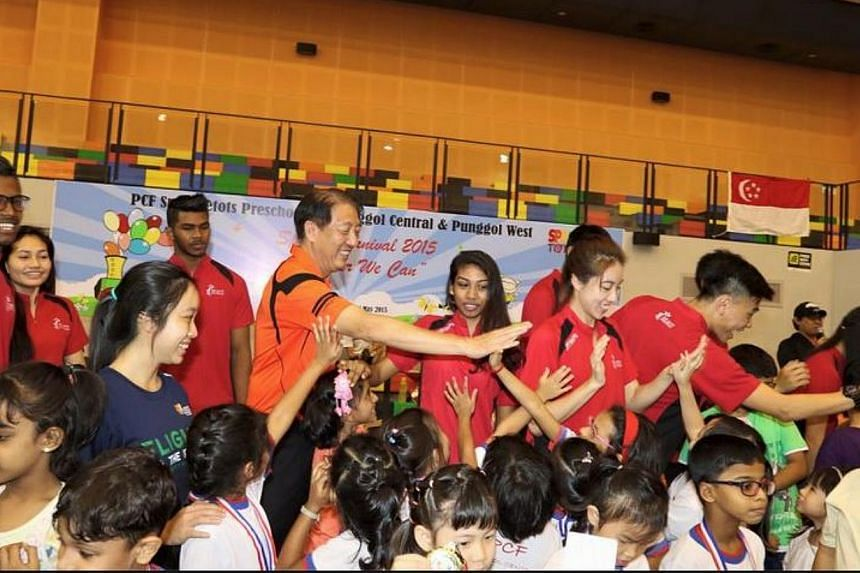 Deputy Prime Minister Teo Chee Hean high-fiving kindergarten children at the Pasir Ris-Punggol GRC's annual sports carnival, on Sunday, May 24, 2015. Mr Teo was there along with fellow Pasir Ris-Punggol MPs Teo Ser Luck, Zainal Sapari and Janil Puthu