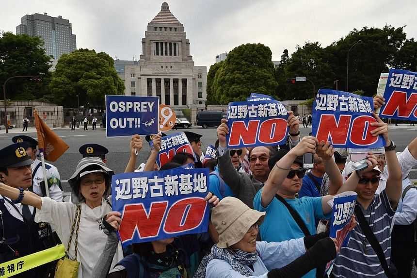 People stage a rally in front of the parliament (centre, top) in Tokyo on May 24, 2015 to protest against a controversial US airbase on Okinawa island, in southern Japan.-- PHOTO: AFP