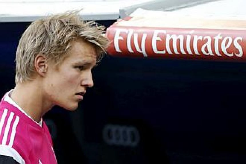 Real Madrid's Martin Odegaard walks to the bench before their match against Getafe at Santiago Bernabeu stadium in Madrid, Spain, May 23, 2015. -- PHOTO: REUTERS