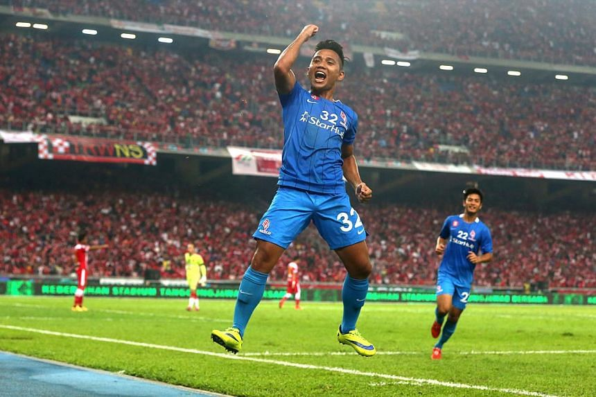 LionsXII striker Sahil Suhaimi celebrating after scoring in the Malaysian FA Cup final against Kelantan at the Bukit Jalil Stadium on May 23, 2015. -- ST PHOTO: NEO XIAOBIN