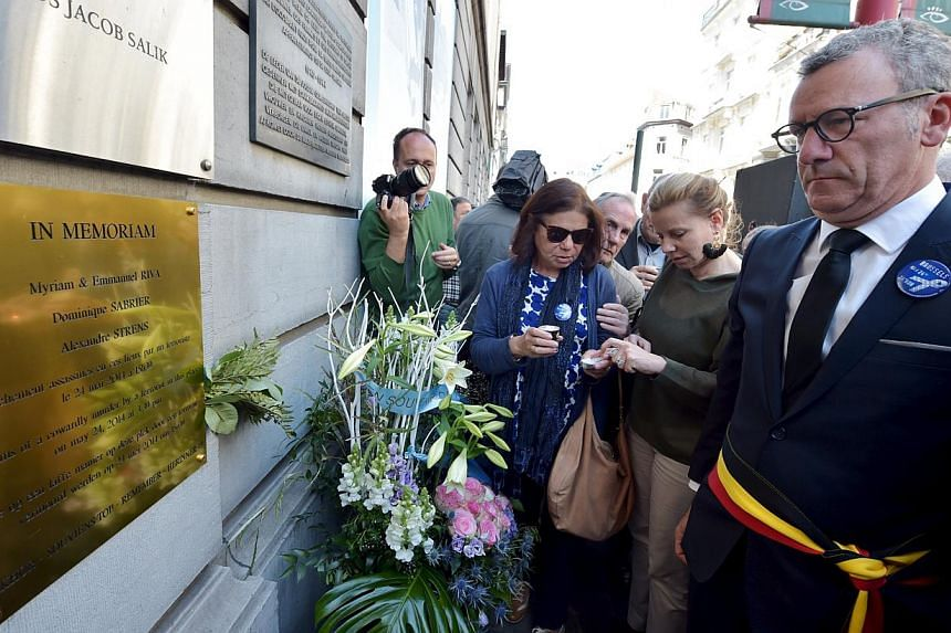 Brussels' Mayor Yvan Mayeur (right) attends a ceremony for the victims of the May 24, 2014 attack at the entrance of the Jewish Museum in Brussels, Belgium, on May 24, 2015. -- PHOTO: REUTERS