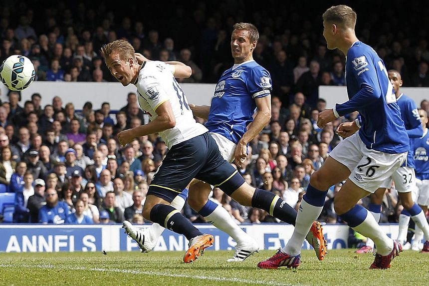 Tottenham Hotspur's Harry Kane scores their first goal against Everton at Goodison Park on May 24, 2015. -- PHOTO: REUTERS