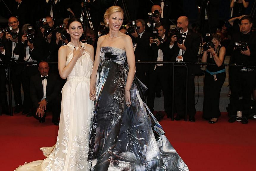 Australian actress Cate Blanchett (right) and US actress Rooney Mara (left) leave the screening of 'Carol' during the 68th annual Cannes Film Festival, in Cannes, France, on May 17, 2015. -- PHOTO: EPA