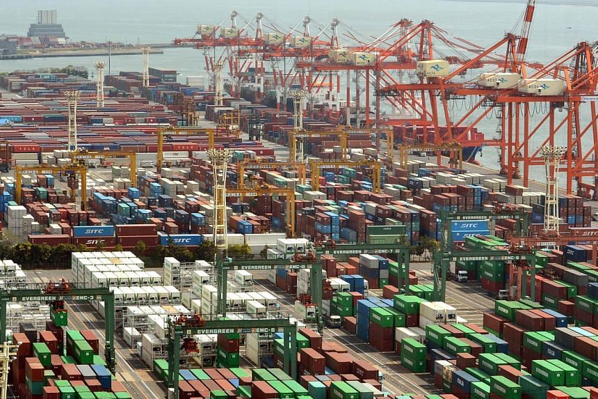 Japan's exports rose 8.0 percent in April from a year earlier, up for an eighth straight month, Ministry of Finance data showed on Monday, underlining a gradual pickup in external demand. -- PHOTO: AFP