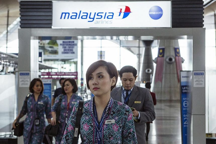 Malaysia Airlines Air Crew Walking Through Kuala Lumpur International Airport In Sepang On