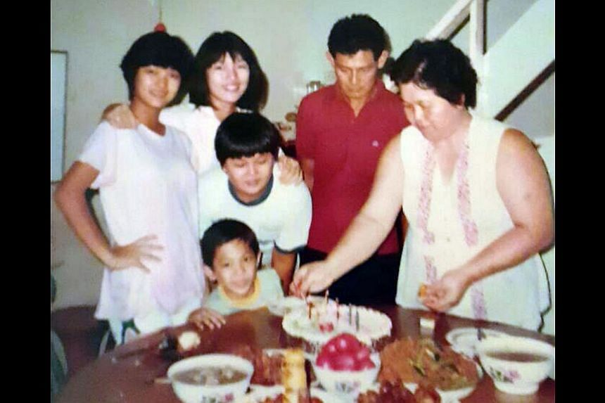Shaun Chen celebrating a birthday (above) with his family. -- PHOTO: COURTESY OF SHAUN CHEN