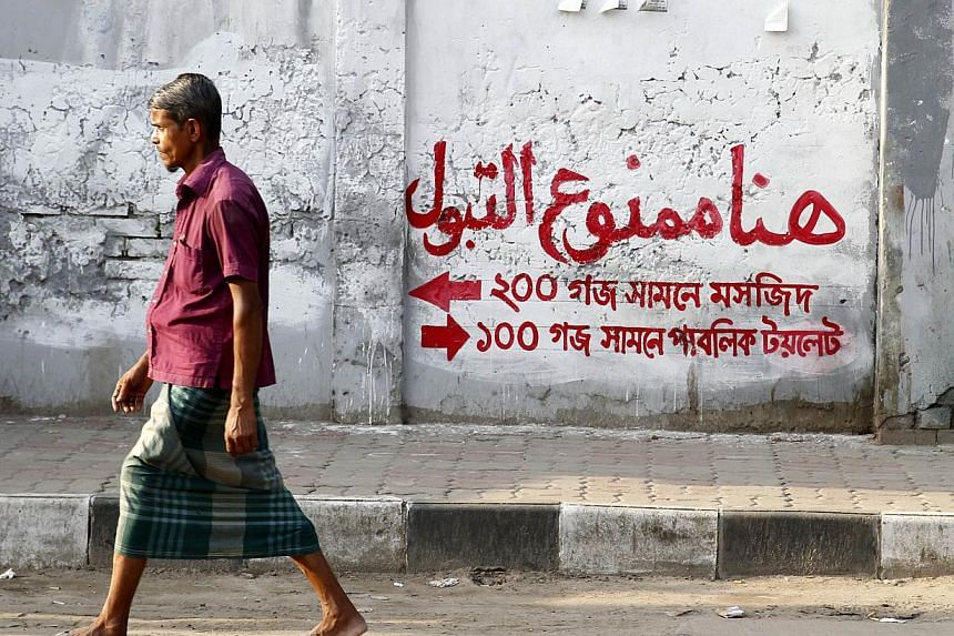 """Dhaka's walls have been peppered with signs warning """"Do not urinate here!"""" in Arabic, in the hope that people will not defile a script they see as holy, even though few Bangladeshis understand the language."""