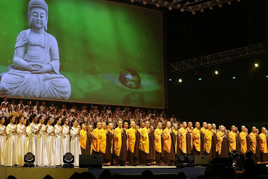 Performers at a concert on May 15, 2015, organised by the Singapore Buddhist Federation to celebrate SG50 and Vesak Day. More than 6,000 people attended the concert, where some 600 performers staged art, song and dance acts. -- ST PHOTO: SEAH KWANG P