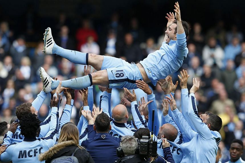 Manchester City's Frank Lampard is thrown in the air by team mates after the game between Manchester City and Southampton on May 24, 2015. -- PHOTO: REUTERS
