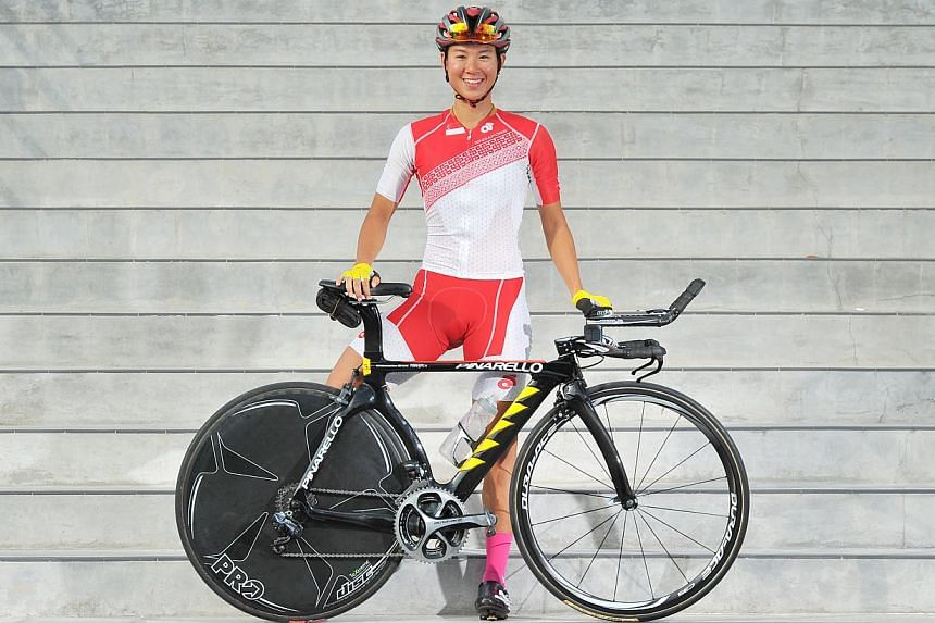 Singapore cyclist and 2013 SEA Games Gold medalist Dinah Chan, 29, has announced she is ready to defend her gold medal at the SEA Games next month. -- ST PHOTO: LIM YAOHUI FOR THE STRAITS TIMES
