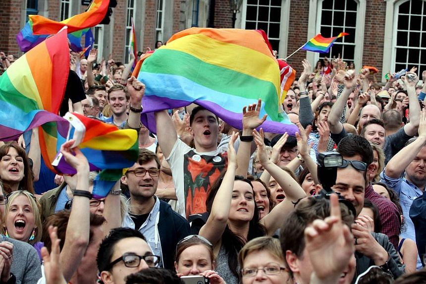 Supporters reacting outside Dublin Castle following the announcement of the result of the same-sex marriage referendum in Dublin, Ireland, on May 23, 2015. -- PHOTO: AFP