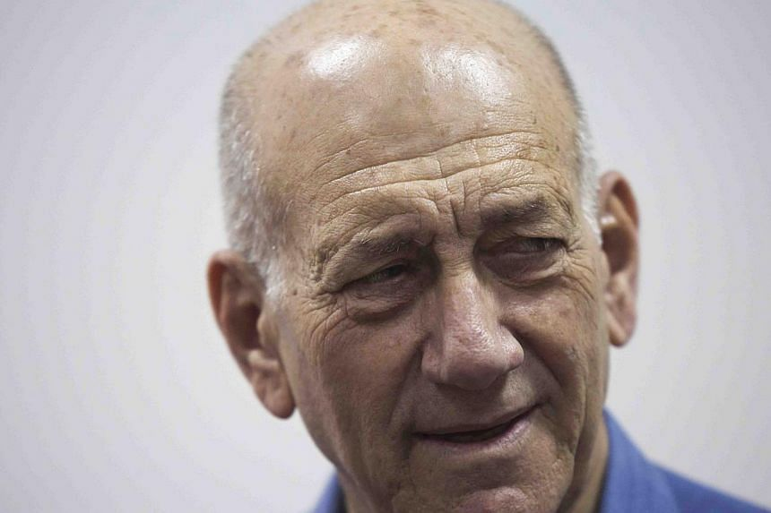 Former Israeli Prime Minister Ehud Olmert appears in Jerusalem District Court on May 25,2015. Former Israeli prime minister Ehud Olmert was sentenced on Monday to eight months' jail for accepting illegal payments from a United States businessman