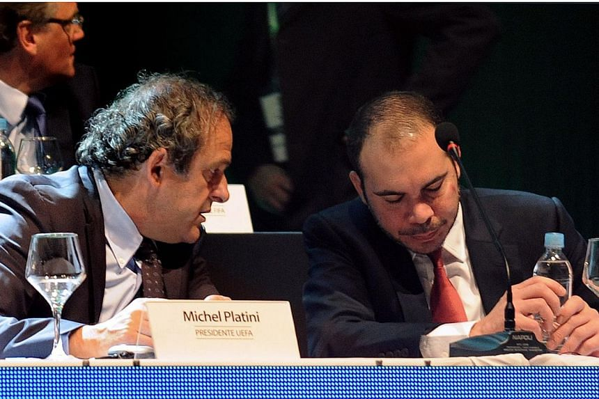 Uefa president Michel Platini (left) and Fifa presidential candidate Jordan Prince Ali bin Al Hussein chat during the 65th Ordinary Congress of the CONMEBOL, at the South American confederation's headquarters in Luque, near Asuncion on March 4, 2015.