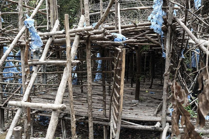 An abandoned migrant camp used by people-smugglers are seen in a jungle at Bukit Wang Burma in the Malaysian northern state of Perlis, which borders Thailand, on May 26, 2015. -- PHOTO: AFP