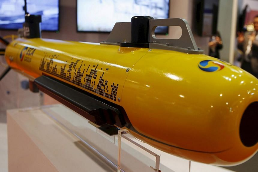 An autonomous underwater vehicle used for surveying the sea floor is displayed at the ECA Robotics booth at the IMDEX Asia maritime defence exhibition in Singapore in this May 19, 2015 file photograph. Southeast Asian nations are prioritising spendin