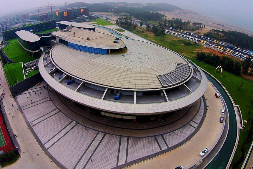 A Chinese millionaire and self-confessed Star Trek fan has boldly gone where no man has gone before with the design of his company headquarters, erected in the shape of the show's spaceship. -- PHOTO: AFP