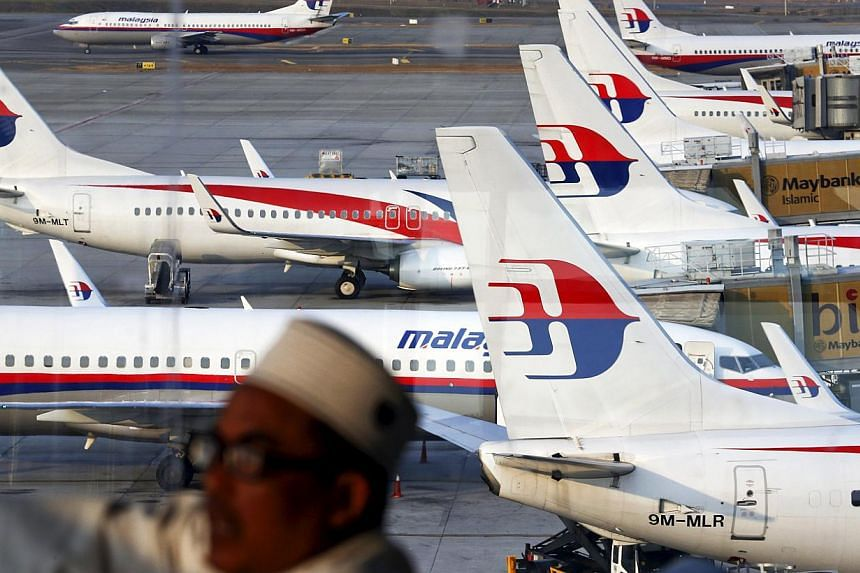 Malaysia Airlines planes are seen on the tarmac at the Kuala Lumpur International Airport in this March 12, 2014 file photograph. The loss-making airline is set to undergo a complete overhaul as it is restructured into a new company. -- PHOTO: REUTER