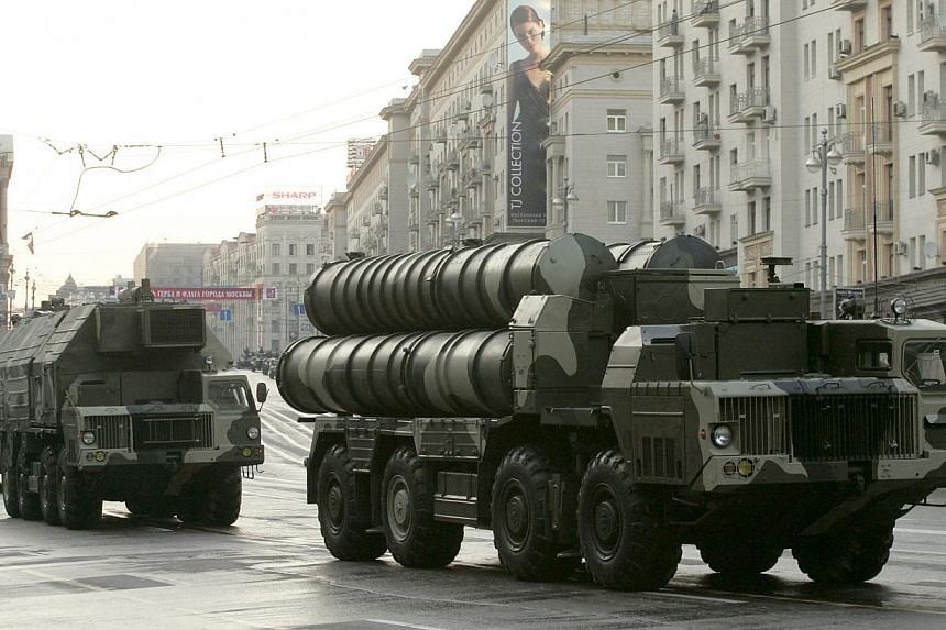 Russian S-300 anti-missile rocket system moving along a central street during a rehearsal for a military parade in Moscow in this May 4, 2009 file photo. -- PHOTO: REUTERS