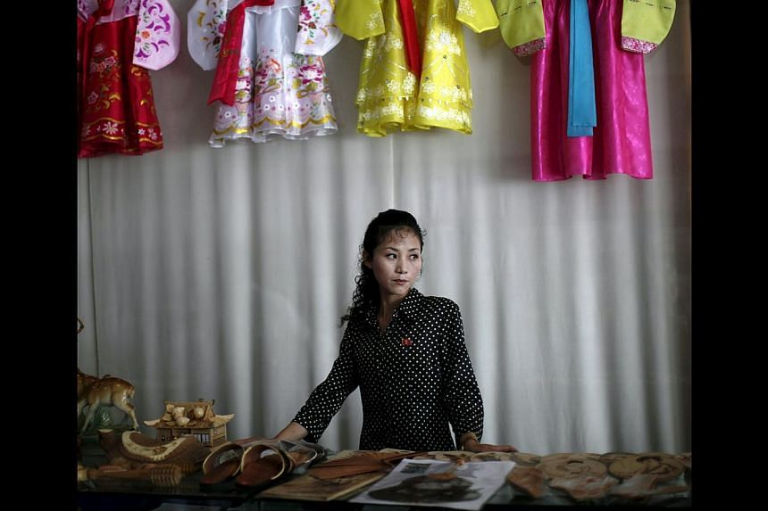 A woman manning a gift shop in Rason city, part of the special economic zone north-east of Pyongyang. North Korea may be a male-dominated society, but it is women who are making the money. They earn more than 70 per cent of household income in North