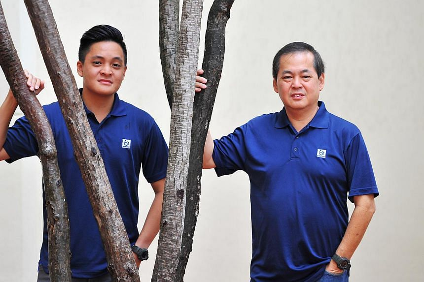 Inspect First (Singapore) director John Wee, and his son Shaun (far left), who is its business development executive. The company examines homes for flaws and whether they meet building and construction standards.