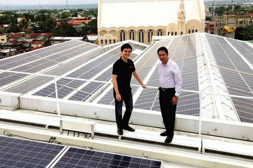 Mr Leandro Leviste (left) and former energy secretary Jericho Petilla at the inauguration of a solar farm at Central Mall in Binan.