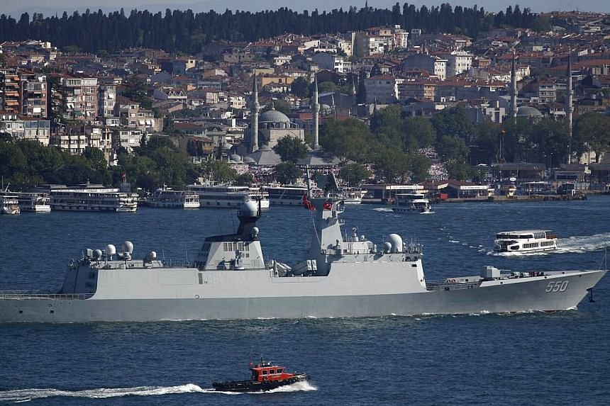 The People's Liberation Army (PLA) navy frigate Weifang setting sail in the Bosphorus, on its way to the Mediterranean Sea in Istanbul, Turkey on May 14, 2015. China has outlined an expanded role for its military and particularly its navy as it seeks
