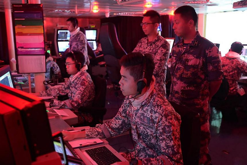A PLA(N) officer (right, standing) observing the conduct of the Air Defence component of Exercise Maritime Cooperation in the Combat Information Centre of RSS Intrepid. The Republic of Singapore Navy (RSN) and the People's Liberation Army (Navy) (PLA