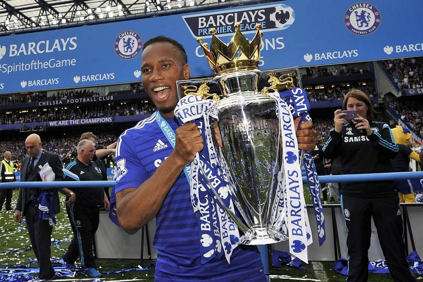 Chelsea's Didier Drogba celebrates with the trophy after winning the Barclays Premier League. -- PHOTO: REUTERS
