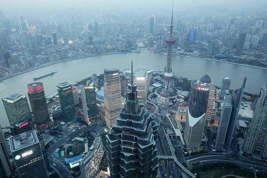 Commerical buildings in the Pudong area of Shanghai, China. Asians surpassed Europeans, but fell behind Americans in the self-made billionaires' 2015 list released by UBS and PwC on Tuesday. -- PHOTO: BLOOMBERG