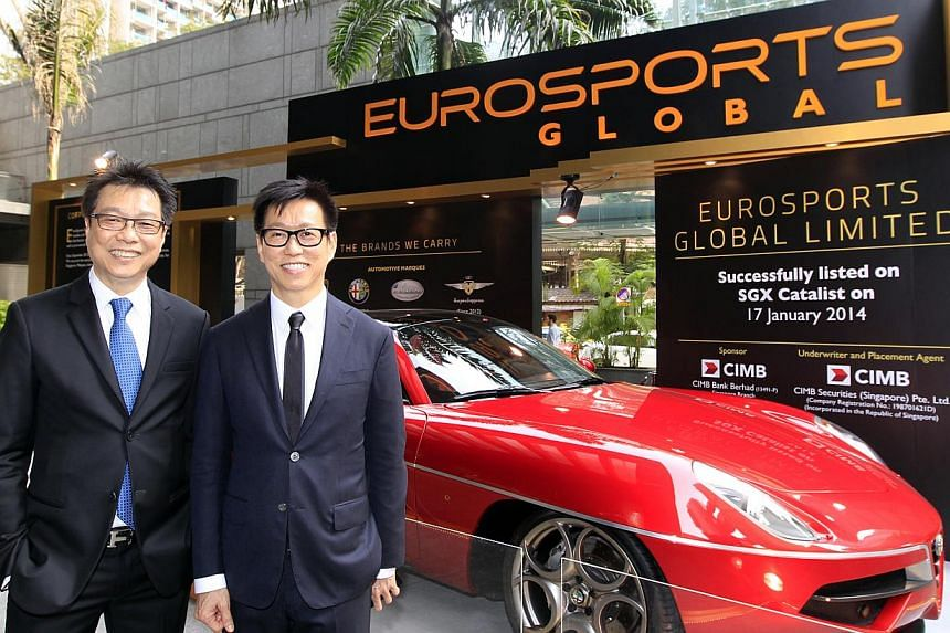 EuroSports Global executive chairman and CEO Melvin Goh (left) and executive director and deputy CEO Andy Goh at the listing ceremony held outside SGX Centre in Shenton Way on Jan 17, 2014. EuroSports Global, the sole authorised Lamborghini dealer in